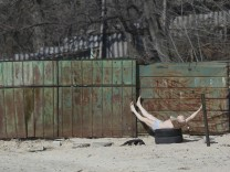 A man sunbathes in Kiev