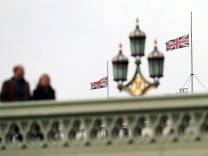 Union flags are flown at half-mast from governmnet buildings, in front of Westminster Bridge the day after an attack, in London