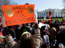 Healthcare demonstrators protest at the White House in Washington