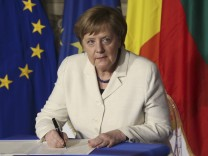 German Chancellor Merkel signs document during the EU leaders meeting on the 60th anniversary of the Treaty of Rome, in Rome