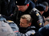 Police officers detain anti-corruption campaigner and opposition figure Alexei Navalny during a rally in Moscow, Russia