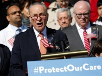 Senate Minority Leader Chuck Schumer speaks at an event marking the seventh anniversary of the passing of the Affordable Care Act outside the Capitol Building in Washington