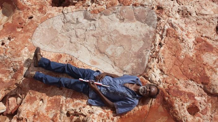 Goolarabooloo Law Boss Richard Hunter and a sauropod track in the Lower Cretaceous Broome Sandstone, Walmadany area, Dampier Peninsula, Western Australia. Photo: Damian Kelly