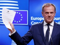 European Council President Donald Tusk shows British Prime Minister Theresa May's Brexit letter in notice of the UK's intention to leave the bloc under Article 50 of the EU's Lisbon Treaty, at the end of a news conference in Brussels