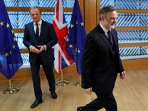 Britain's permanent representative to the European Union Tim Barrow leaves after he delivered British Prime Minister Theresa May's Brexit letter to EU Council President Donald Tusk in Brussels