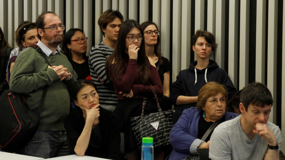 Students of the Hungary-based Central European University listen to the school's rector, Michael Ignatieff, address a town hall meeting
