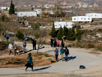 FILE PHOTO: Israelis prepare for an expected eviction of the Jewish settlement outpost of Amona