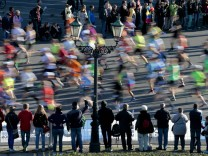 Spectators watch as runners compete in the 40th Berlin marathon