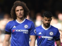 Chelsea's David Luiz looks dejected