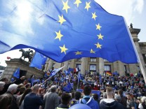 Participants of the Pro-Europe 'Pluse of Europe' movement wave European Union flags during a protest at Gendarmenmarkt square in Berlin