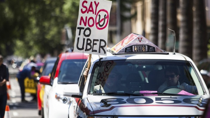 Taxi drivers protest against transportation network companies such as Uber and Lyft along with Assembly Bill 2293 at the State Capitol in Sacramento, California