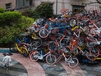 Over 500 rented bikes piled up broken in Shenzhen residential community