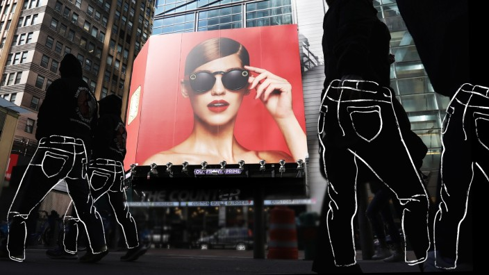 People walk past a Snap Inc billboard in Times Square