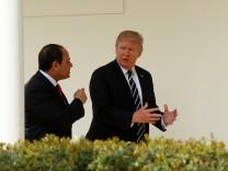Trump walks with Egypt President Abdel Fattah al-Sisi at the White House in Washington