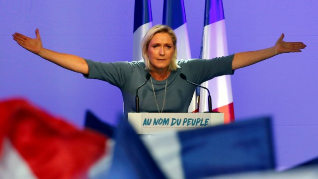 FILE PHOTO: Marine Le Pen, French National Front (FN) political party leader, gestures during an FN political rally in Frejus