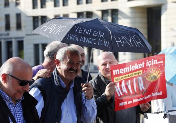 People attend an anti-Turkish President Erdogan prostest in front of the Brandenburg Gate in Berlin