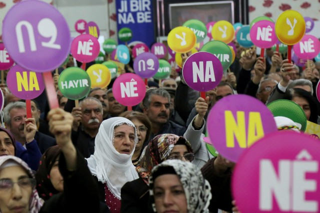 Supporters of pro-Kurdish opposition HDP hold 'No' placards in Turkish and Kurdish during a campaign meeting for the April 16 constitutional referendum, in Diyarbakir