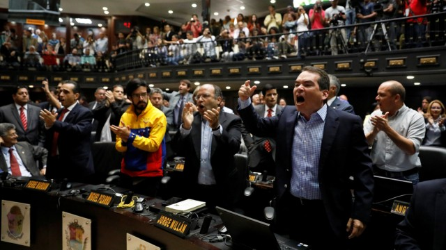 Tomas Guanipa, deputy of the Venezuelan coalition of opposition parties, shouts slogans during a session of the National Assembly in Caracas