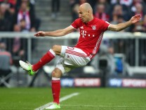 Bayern Munich's Arjen Robben scores their third goal