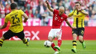 Bayern Munich's Arjen Robben shoots at goal