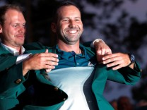 Garcia of Spain is presented the green jacket by Willett of England after Garcia won the 2017 Masters in Augusta