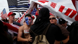 Pro-Trump rally participants mix with Anti-Trump protester as the two sides clash during a Pro-Trump rally in Huntington Beach