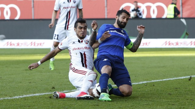 Ingolstadt's Dario Lezcano shoots at goal past the challenge of Darmstadt's Aytac Sulu