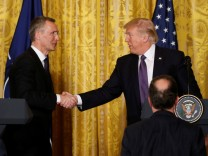 U.S. President Trump and NATO Secretary General Stoltenberg shake hands at joint news conference at the White House in Washington