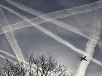 Aircraft contrails in the skies near Heathrow Airport in west London