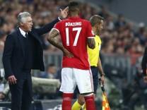 Bayern Munich coach Carlo Ancelotti  speaks to Jerome Boateng during the game