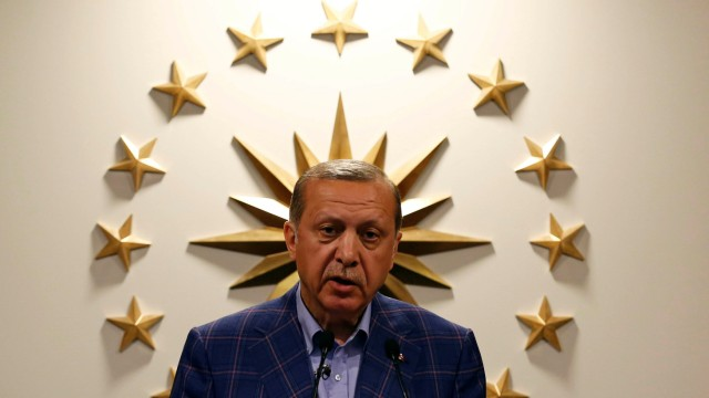 Turkish President Erdogan speaks during a news conference in Istanbul