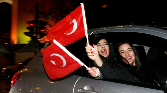 People of the Turkish community living in Germany, supporting Erdogan celebrate on Kurfuerstendamm boulevard after news bulletins on the outcome of Turkey's referendum on the constitution, in Berlin