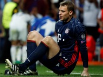 Bayern Munich's Jerome Boateng checks on Bayern Munich's goalkeeper Manuel Neuer after he injured his left foot during their UEFA Champions League quarterfinal second leg match against Real Madrid at Santiago Bernabeu stadium in Madrid