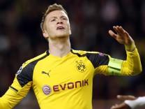 Borussia Dortmund's Marco Reus looks dejected