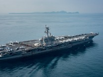 The U.S. aircraft carrier USS Carl Vinson transits the Sunda Strait Indonesia