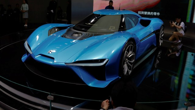People gather around Nio EP9 electric car displayed at the auto show in Shanghai