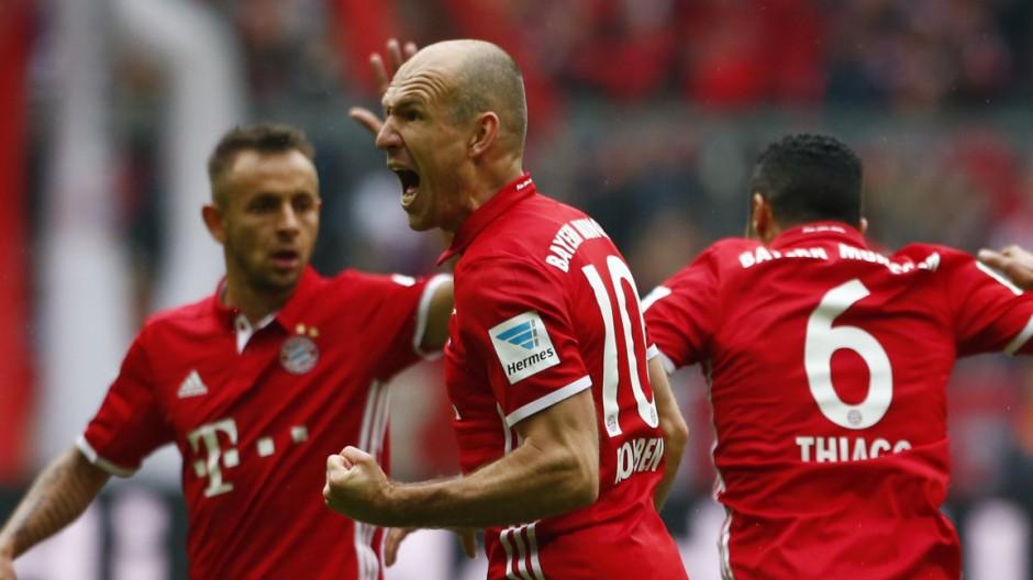 Bayern Munich's Thiago Alcantara celebrates scoring their second goal with Arjen Robben