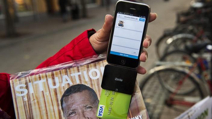 Zahlen mit Kreditkarten und Smartphones