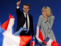 Emmanuel Macron, head of the political movement En Marche !, or Onwards !, and candidate for the 2017 French presidential election, arrives with his wife Brigitte Trogneux to deliver a speech at the Parc des Expositions hall in Paris