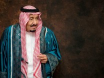 FILE PHOTO: Saudi Arabia's King Salman poses after receiving an an honorary PhD from International Islamic University Malaysia (IIUM) in Kuala Lumpur