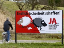Posters of Swiss People's Party demanding to deport criminal foreigners are displayed in Adliswil
