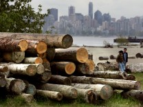 FILE PHOTO: Logs sit piled on a Vancouver beach