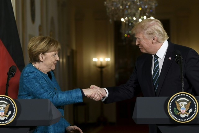 US President Donald Trump and German Chancellor Angela Merkel hold a joint press conference