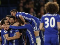 Chelsea's Diego Costa celebrates scoring their third goal with teammates