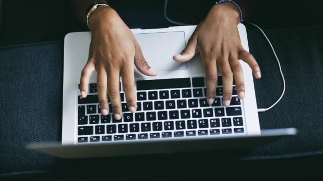 Woman s hand typing on keyboard of laptop model released Symbolfoto property released PUBLICATIONxIN