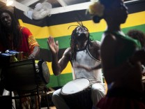 Drummers play to the beat of reggae music in Negril, Jamaica.