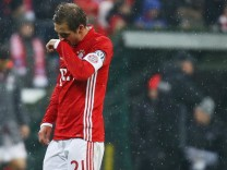 Bayern Munich's Philipp Lahm looks dejected