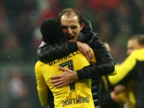 Borussia Dortmund coach Thomas Tuchel and Ousmane Dembele celebrate after the match