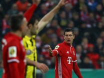 Bayern Munich's Robert Lewandowski reacts
