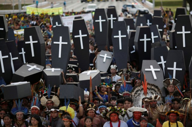 Brazilian Indians take part in a demonstration against the violation of indigenous people's rights, in Brasilia